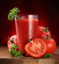 Still-life Of Fresh Tomatoes And Its Juice. Royalty Free Stock Photography - 16724737