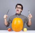 The Young Mad Men Try To Eat Apples And Pumpkin. Stock Photo - 16755870