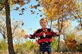Boy Playing In Fall Leaves Royalty Free Stock Photography - 16792377