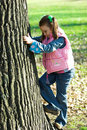 A Little Pretty Girl Climbing Tree Stock Photos - 1684063