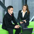 A Young Business Couple Is Working Together Stock Photos - 16848643