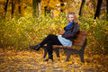Girl In Autumn Park Royalty Free Stock Images - 16888769