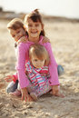 Kids Playing At The Beach Stock Photos - 16896153