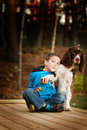 Little Boy With His Pet Dog Royalty Free Stock Photo - 16909345