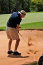 Man Playing Golf Shot Out Of Sand Bunker On Green Royalty Free Stock Photos - 16912688