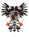 Two-headed Heraldic Eagle With A Shield Stock Photography - 16991202