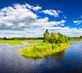 Island With Trees On Blue Cold Lake Stock Photography - 17008432