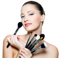 Beautiful Young  Woman  Holding Make-up Brushes Royalty Free Stock Photo - 17009245