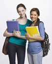 Students Carrying Book Bag, Backpack And Notebooks Royalty Free Stock Photos - 17048188