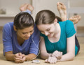 Teenage Girls Sharing Mp3 Player Royalty Free Stock Images - 17049149