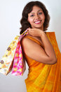 Indian Woman In Traditional Saree With Shopping Ba Stock Photos - 17053113