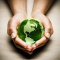 Hands With Green Earth Globe Stock Photos - 17055733