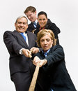 Business People Playing Tug-of-war Royalty Free Stock Image - 17055886