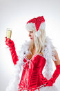 Mrs. Santa Looking At Champagne Glass Royalty Free Stock Photo - 17072305