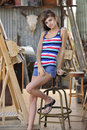 Young Brunette Sitting At Painters Easel Stock Image - 17076161