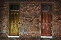 Two Old Wooden Doors In Brick Wall Stock Image - 17243981