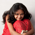Shy Smile Of Beautiful Indian Girl Royalty Free Stock Photo - 17316025