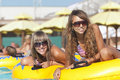 Two Ladies Lying On Inflatable Ring Royalty Free Stock Photography - 17318697
