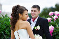 Happy Bride And Groom Near Peony Flowers Royalty Free Stock Images - 17340599