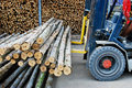 Truck Loading Pile Of Wood In Logs Storage Royalty Free Stock Images - 17380069