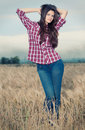 Beautiful Cowboy Woman Posing In Field Royalty Free Stock Photo - 17394135