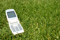 Mobile Cell Phone On Grass Outside Stock Images - 1743574