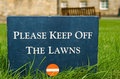 Please Keep Off The Lawns � Stone Sign In The Park Royalty Free Stock Photo - 1747735