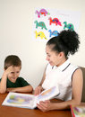 A Teacher Reads A Book With Her Preschool Student Royalty Free Stock Photo - 17407005