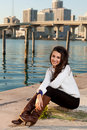 Pretty Young Woman Along The Bay With Skyline Royalty Free Stock Photos - 17461788
