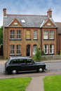 Old Car In Front Of A Typical House In Harlow, UK Royalty Free Stock Images - 17659329