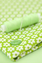 Sewing Items On Floral Cloth Royalty Free Stock Images - 17733689