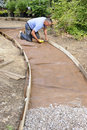 Man Building Gravel Path Royalty Free Stock Images - 17735259