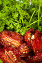 Ripe Red Sun-dried Tomatoes With Parsley Royalty Free Stock Photo - 17747155