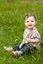 Boy On Grass Royalty Free Stock Photo - 17784065