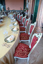 Chairs And Dinner Table With Empty Dishes Stock Photography - 17887732