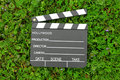 Cinema Clapper Board On Green Grass Royalty Free Stock Photo - 17889065