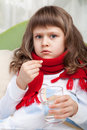 Little Sick Girl In Bed Is Taking A Pill Royalty Free Stock Images - 17898549
