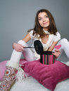 Girl Sits On Pillows With Heart In Her Hands Royalty Free Stock Photo - 17901385