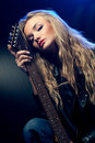 Blond Woman Portrait With Guitar Royalty Free Stock Photography - 17977947