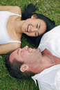 Couple Lying On Lawn And Laugh Royalty Free Stock Photos - 18044078
