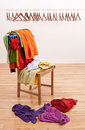Messy Clothes On A Chair And Empty Hangers Stock Images - 18089634