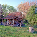 Log Cabin In Woods With Ax  Stock Photography - 1814792