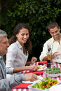 Happy Family Eating In The Garden Royalty Free Stock Photo - 18104325