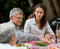 Happy Family Eating In The Garden Stock Images - 18104384