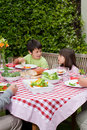 Happy Family Eating In The Garden Stock Image - 18104591