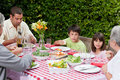 Happy Family Eating In The Garden Stock Photography - 18104682