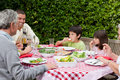 Happy Family Eating In The Garden Stock Image - 18104701