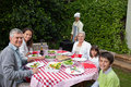Happy Family Eating In The Garden Royalty Free Stock Image - 18104976