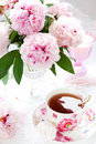 Pink Peonies And Cup Of Tea Royalty Free Stock Image - 18121596