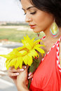 Girl With Sunflower Close Up Royalty Free Stock Photo - 18129535